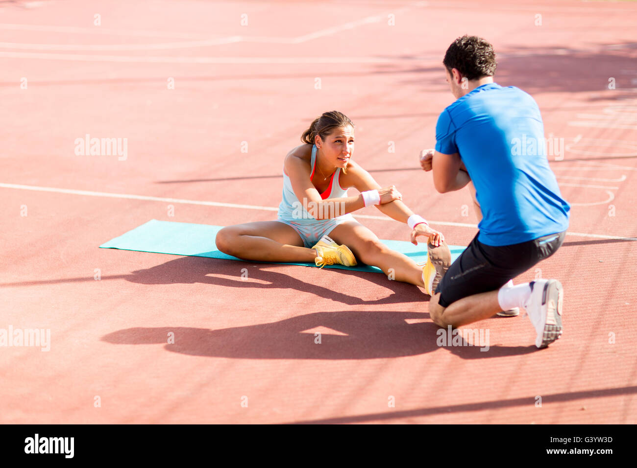 Woman training with personal trainer outdoor - Stock Image