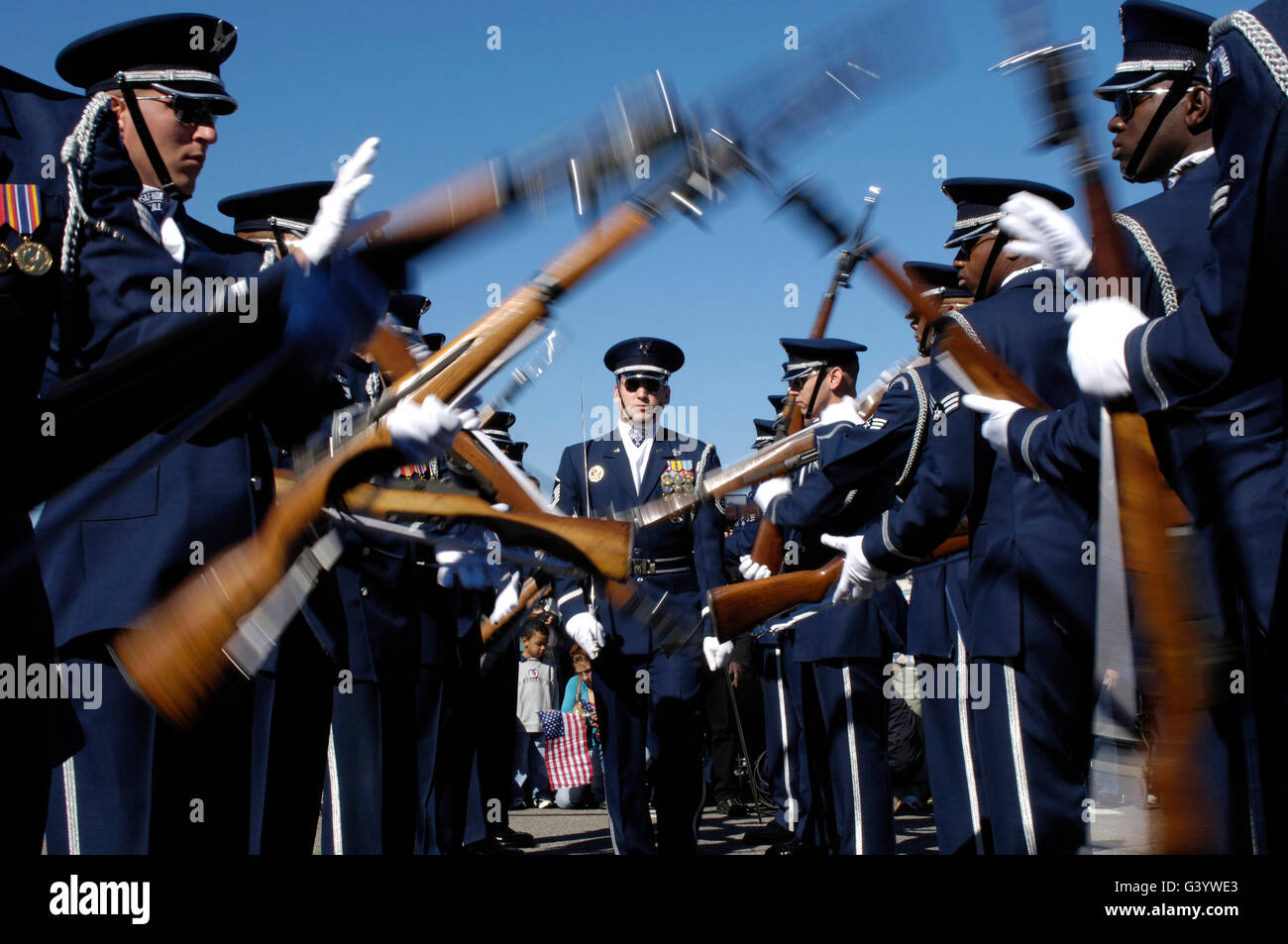 Members of the United States Air Force Drill Team perform. - Stock Image