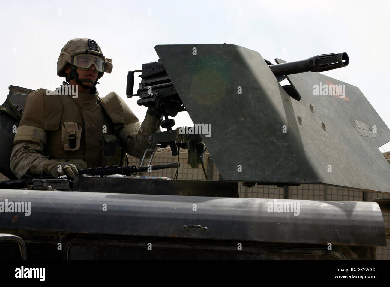 A MK-19 automatic grenade launcher gunner. - Stock Image