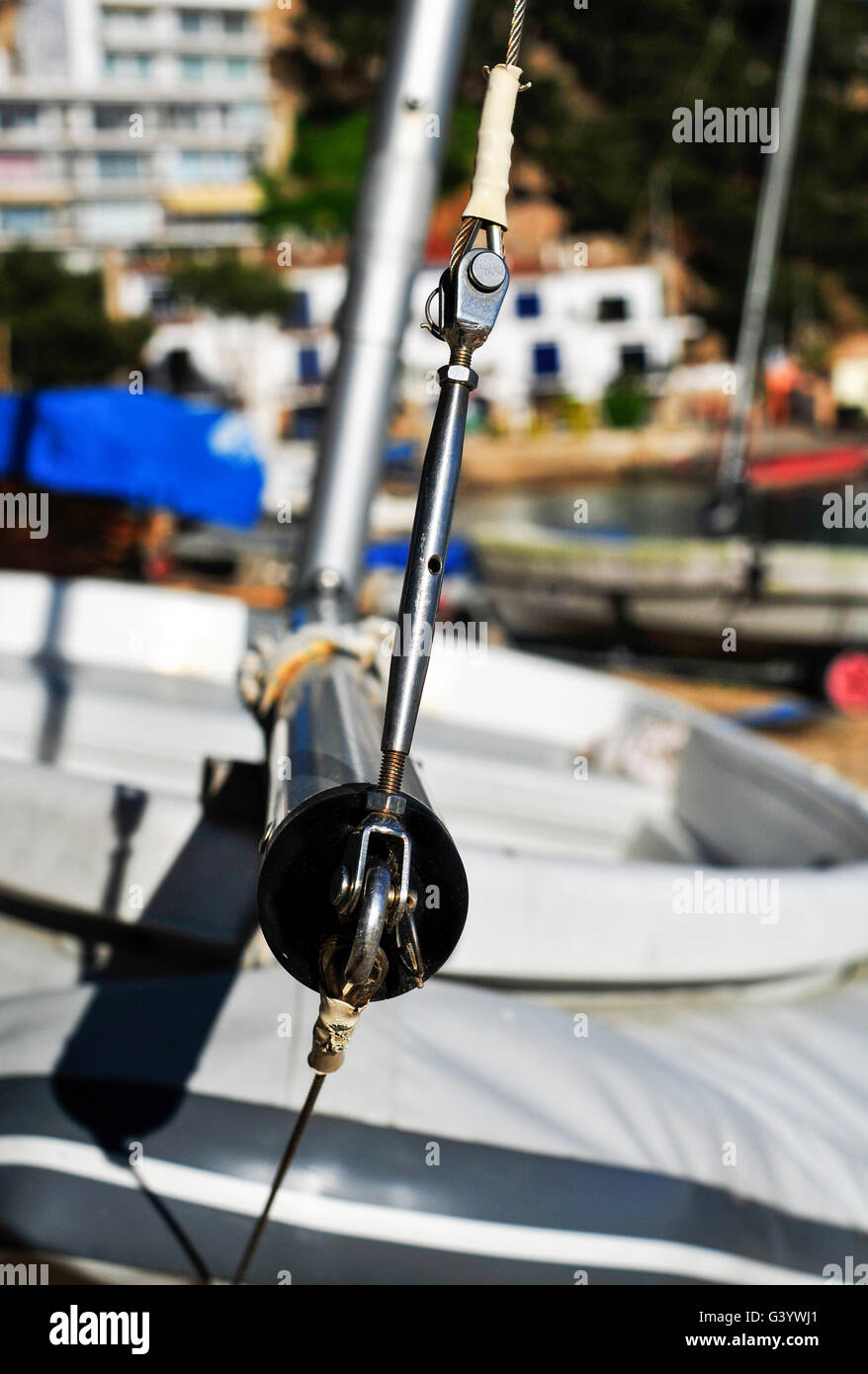 closeup of some sailing boats stranded in a beach in a Mediterranean village - Stock Image