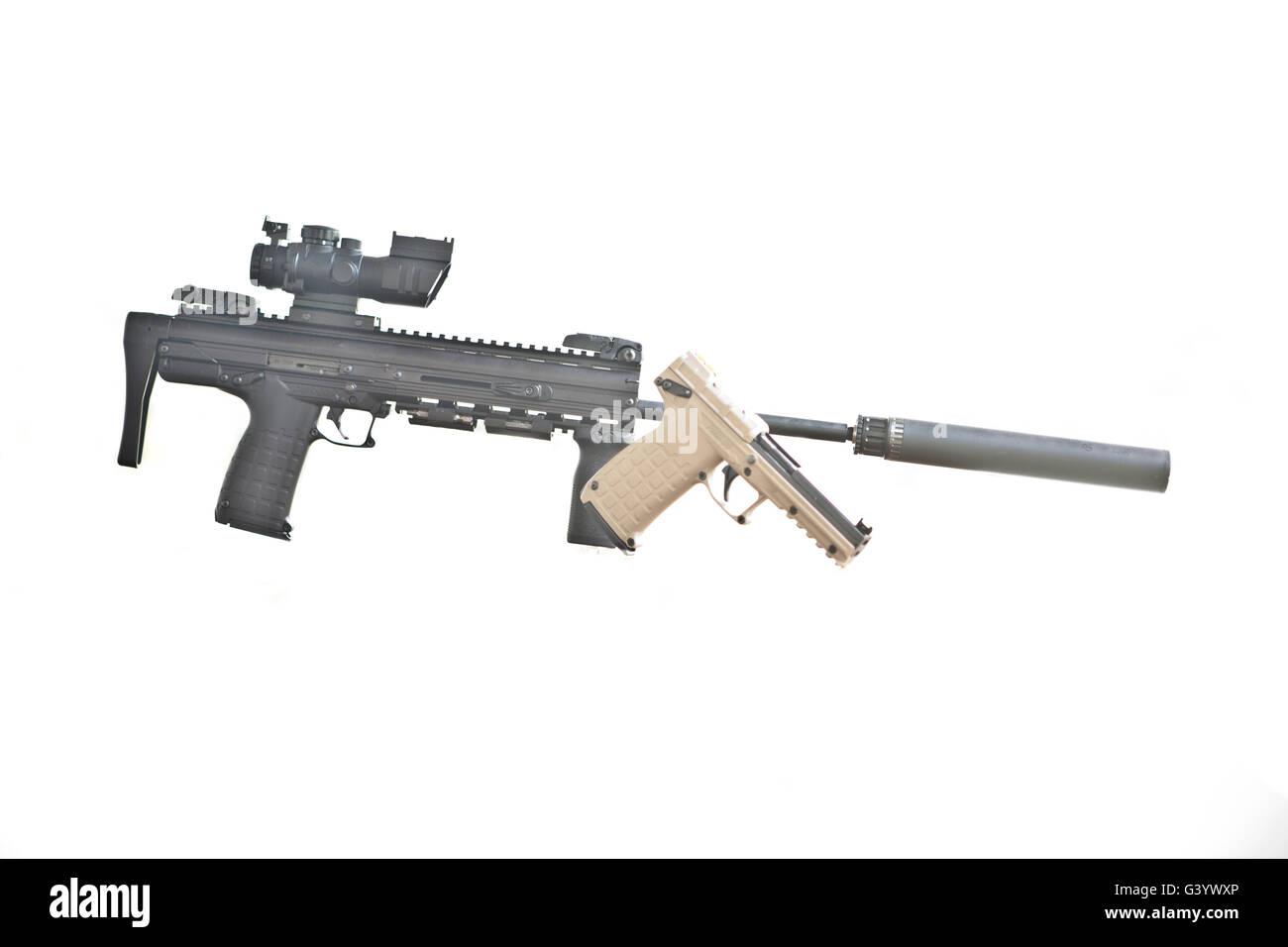 Kel-Tec PMR30 Pistol in front of a Kel-Tec CMR30 Carbine that has a Liberty Suppressor attached - Stock Image