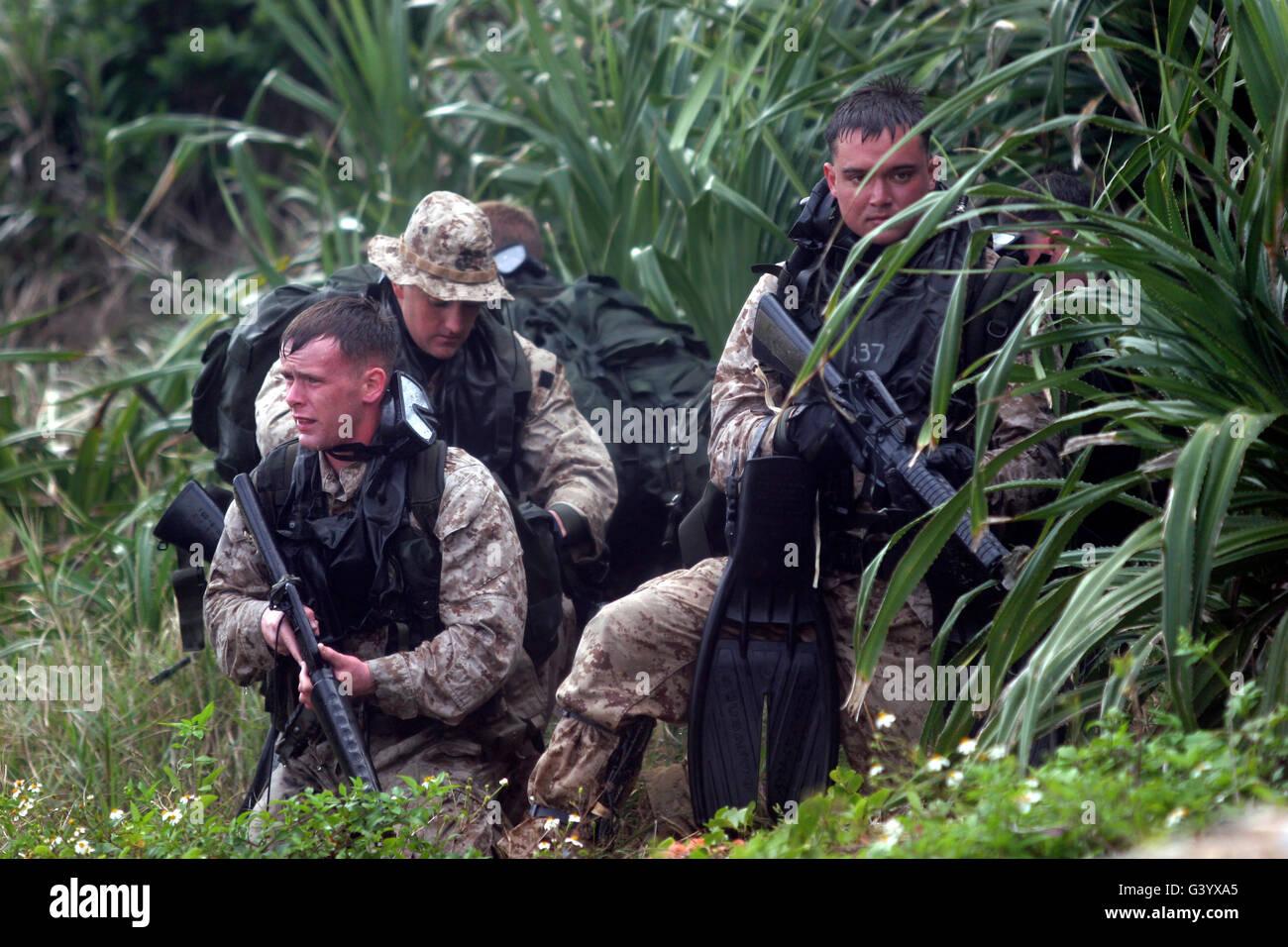 Reconnaissance men perform a gear check. - Stock Image