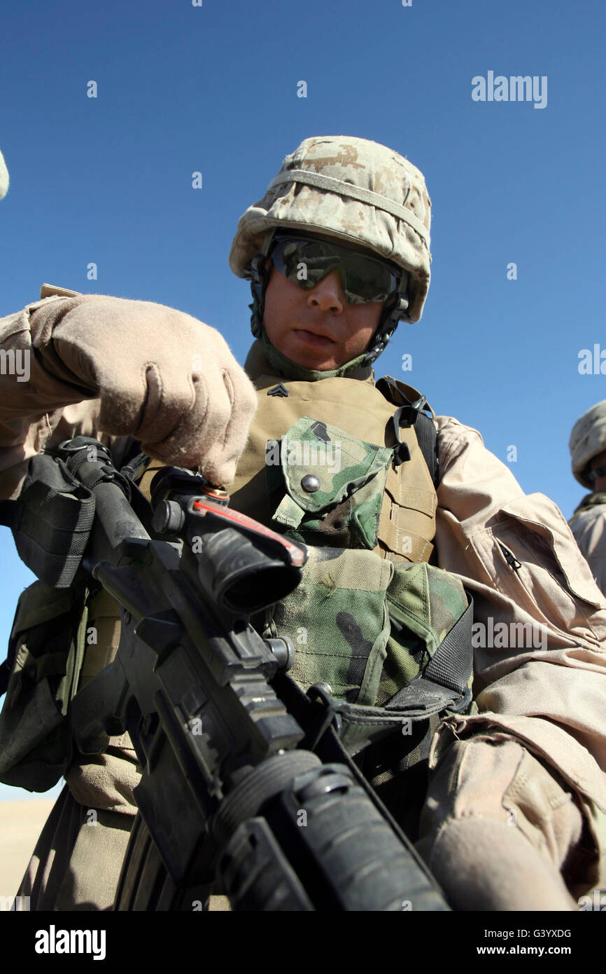 A marine adjusts his scope. - Stock Image