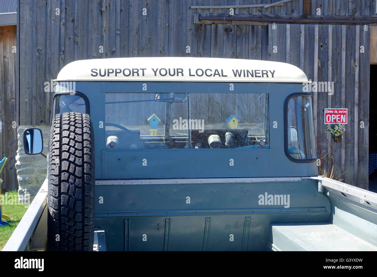 A British Land Rover Pick Up Truck At A Prince Edward County Ontario Winery With A Sign, Support Your Local Winery - Stock Image