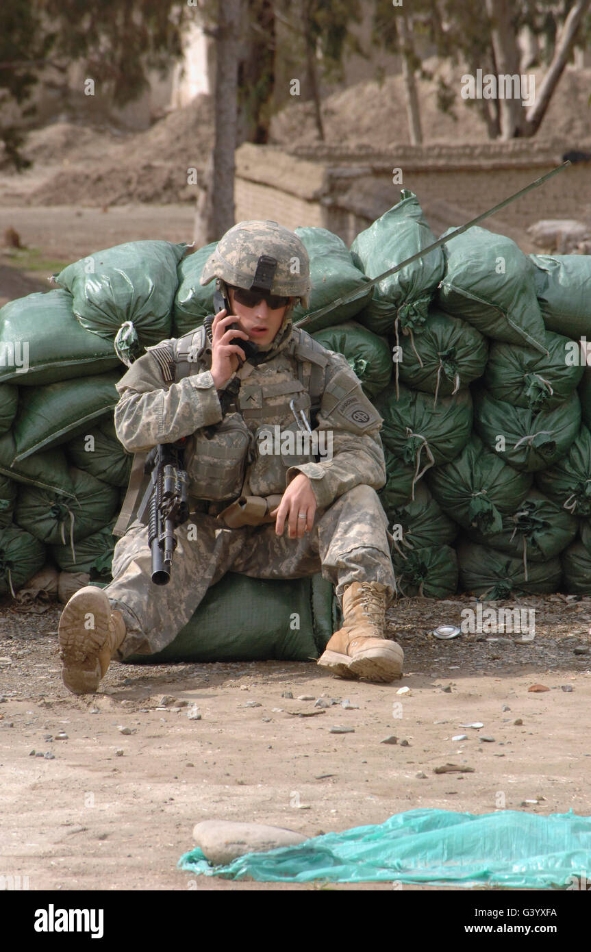 A U.S. Army Soldier talks on a radio. - Stock Image