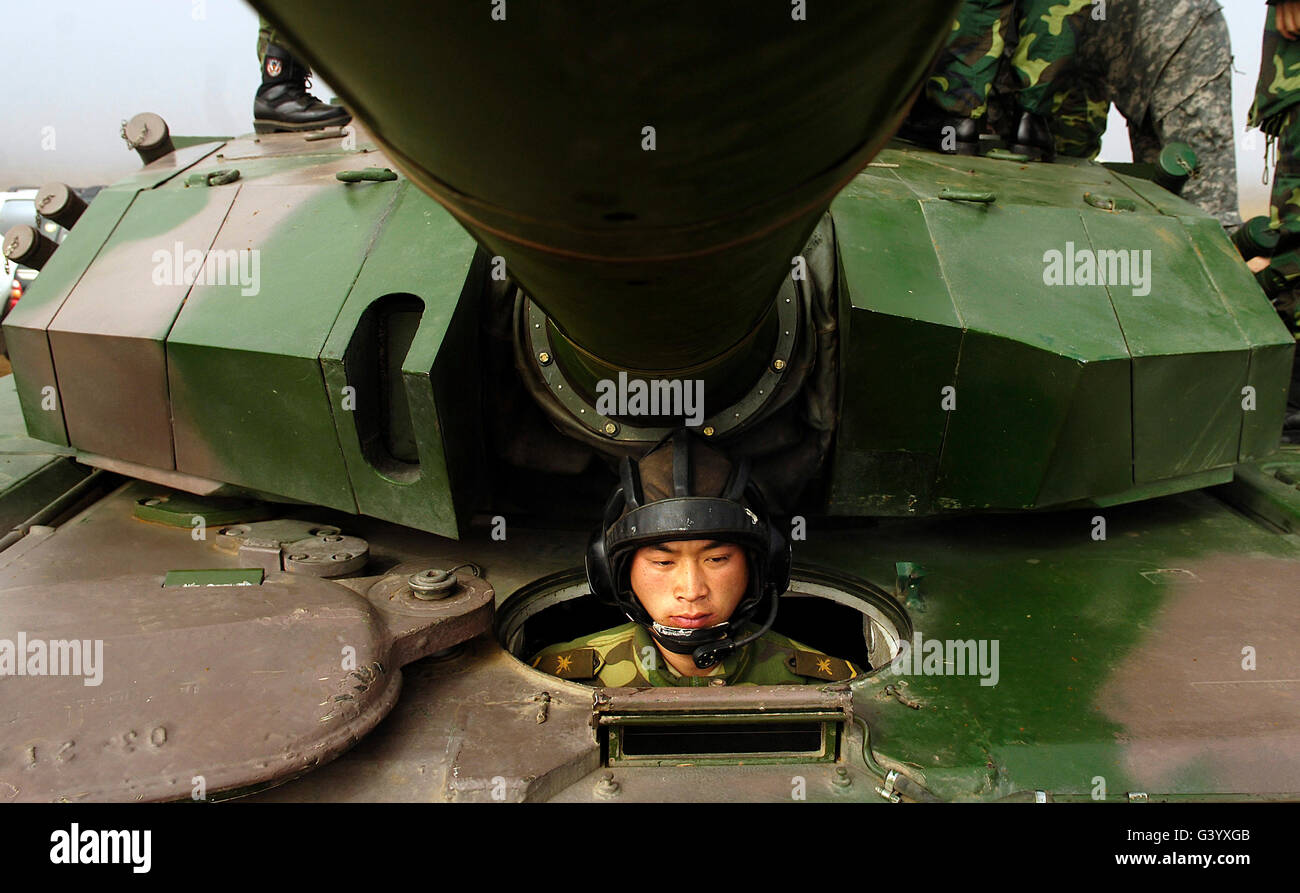 A Chinese tanker soldier with the People's Liberation Army sits in his tank. Stock Photo