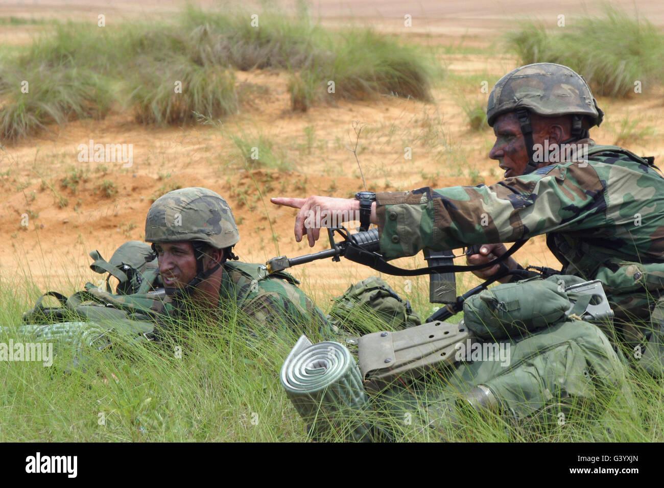 Combat Control School students practice pulling security . - Stock Image
