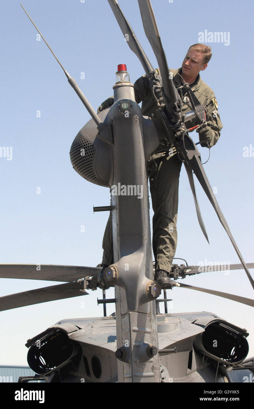 Sergeant inspects an HH-60 Pave Hawk rotor tail assembly. - Stock Image