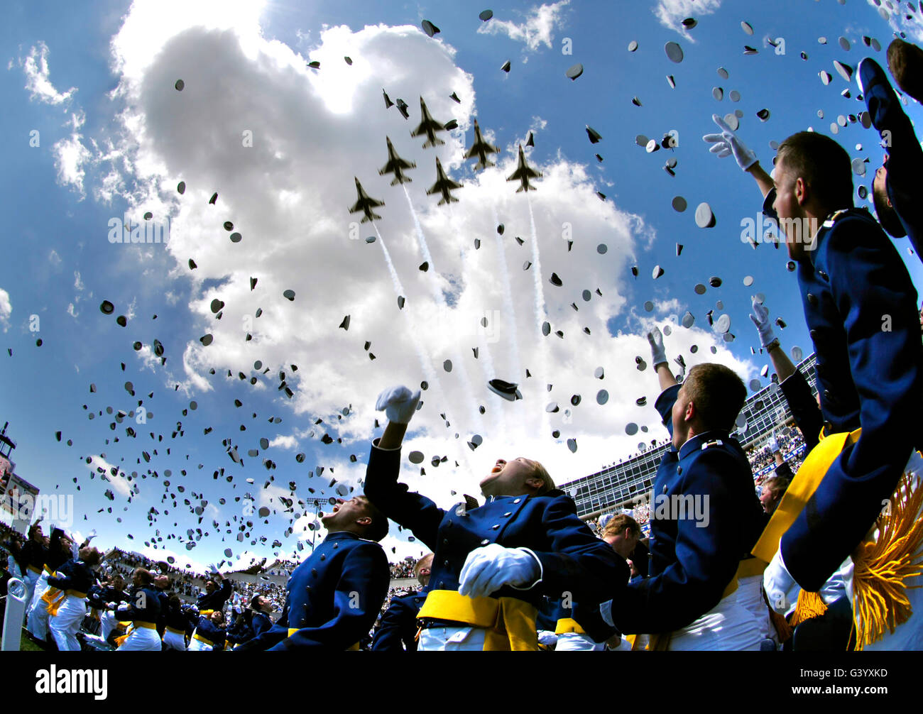 U.S. Air Force Academy graduates throw their hats in the air. Stock Photo