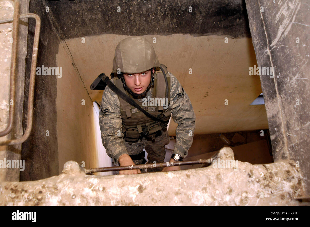 Airman climbs to the top of a lookout point. - Stock Image