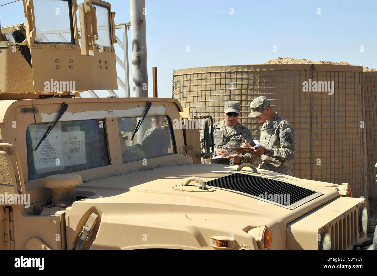 U.S. Army soldiers take accountability of an M1114 HMMWV. - Stock Image