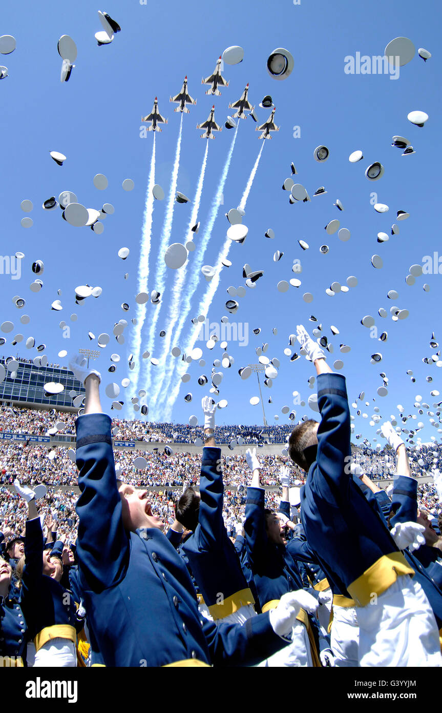 Lieutenants commemorate their achievement by tossing their hats in the air. - Stock Image
