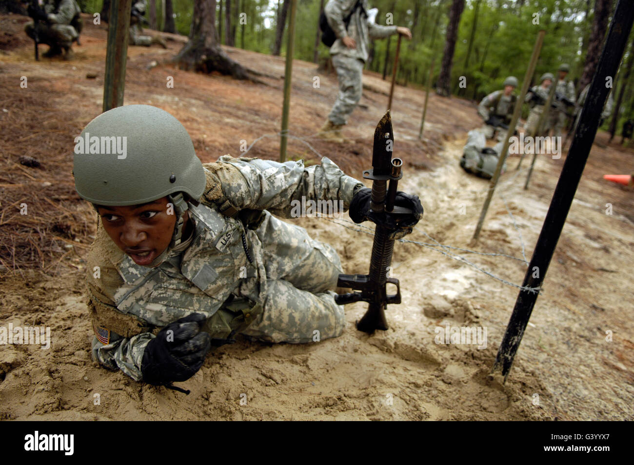 A U.S. Army recruit negotiating the confidence course during basic combat training at Fort Jackson, South Carolina. - Stock Image