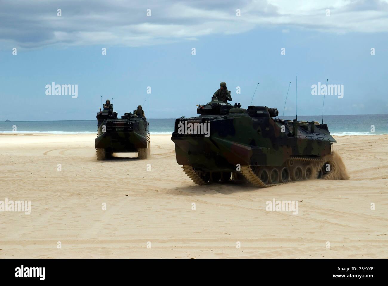 Armored assault vehicles performing maneuvers at Pacific Missile Range Facility at Barking Sands, Hawaii. Stock Photo