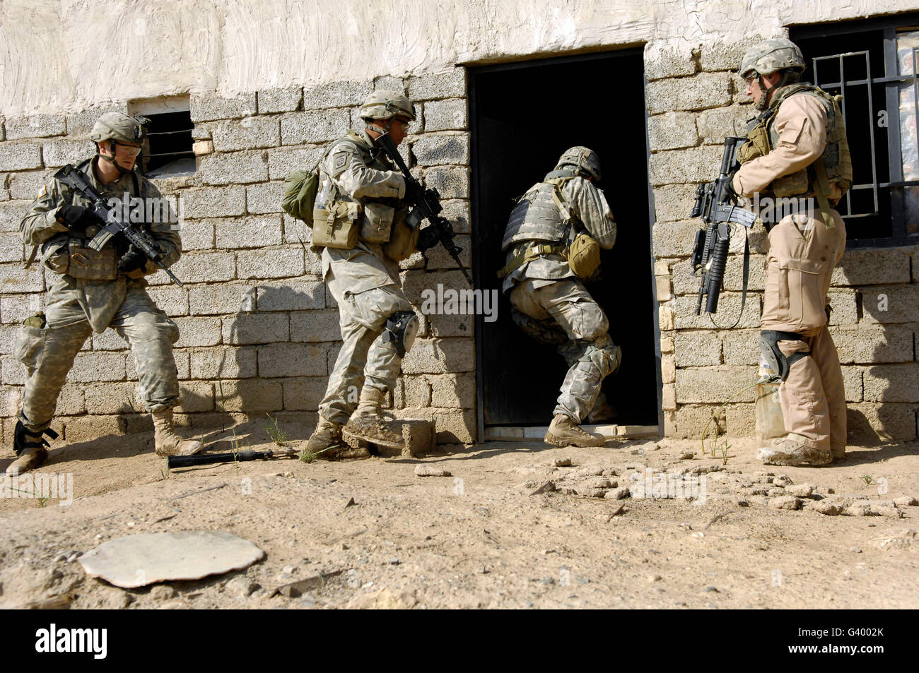 U.S. Army soldiers breaching a house to search for insurgent activities in Zaghiniyat Iraq. & Breaching Door Stock Photos \u0026 Breaching Door Stock Images - Alamy