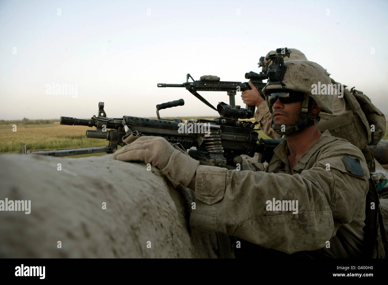 U.S. Marines observe the movement of enemy forces. - Stock Image