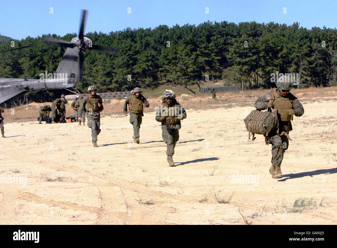 U.S. Navy corpsmen respond to a mass casualty evacuation exercise. - Stock Image
