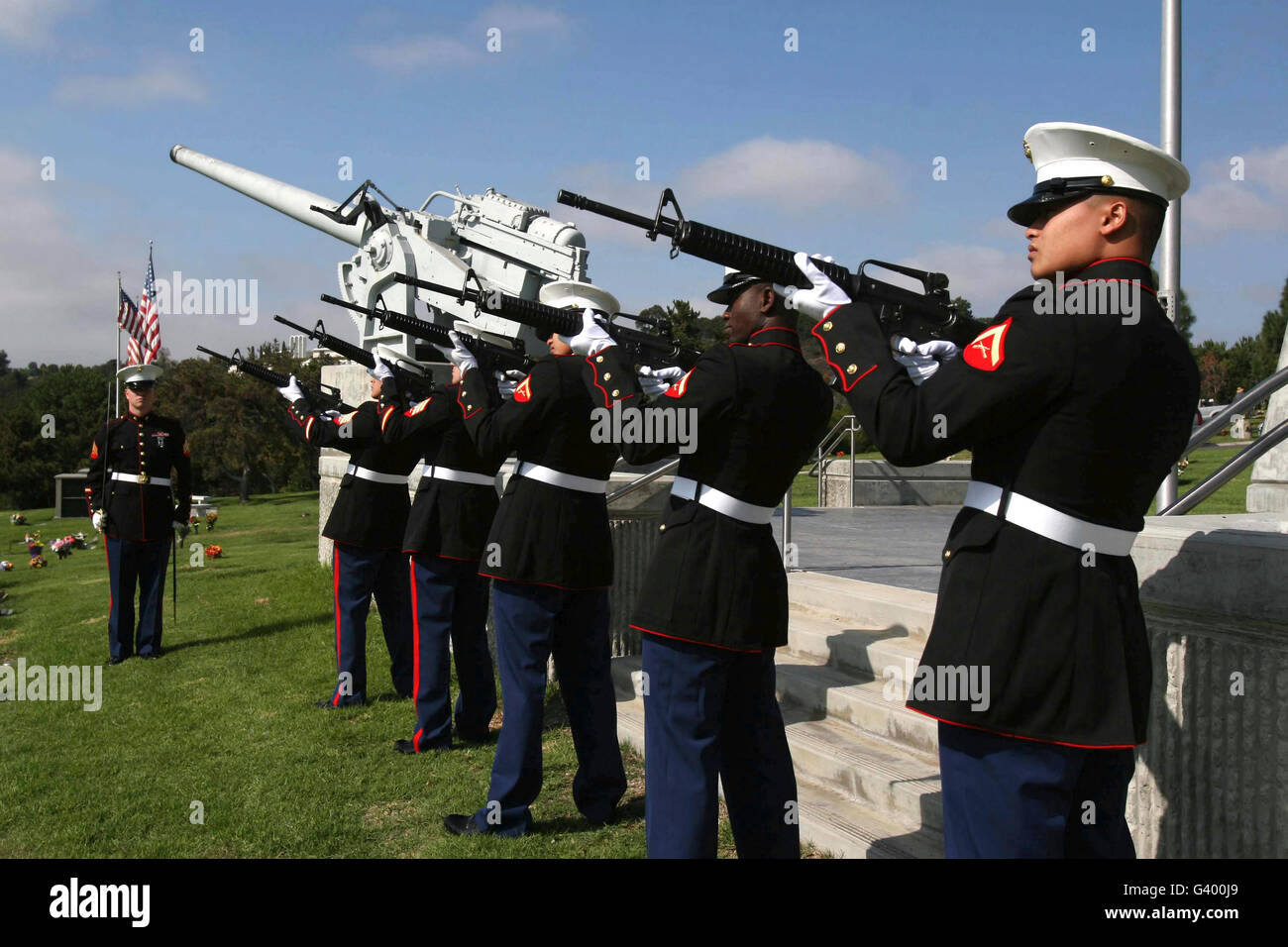 Marines practices drill movements for a funeral. - Stock Image