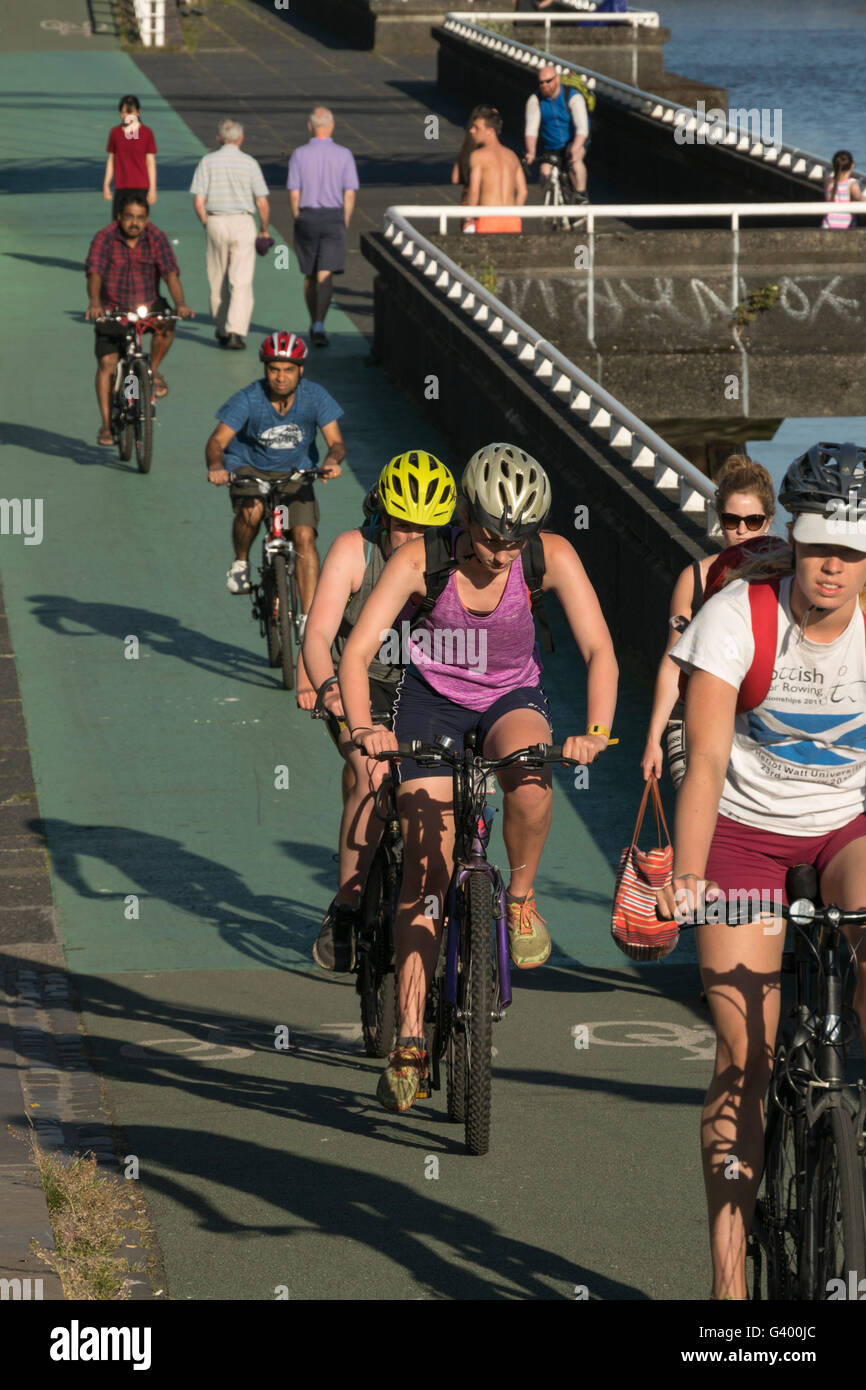 Cyclists on Clydeside cycle route during hot weather, Glasgow, Scotland,  UK, Stock Photo
