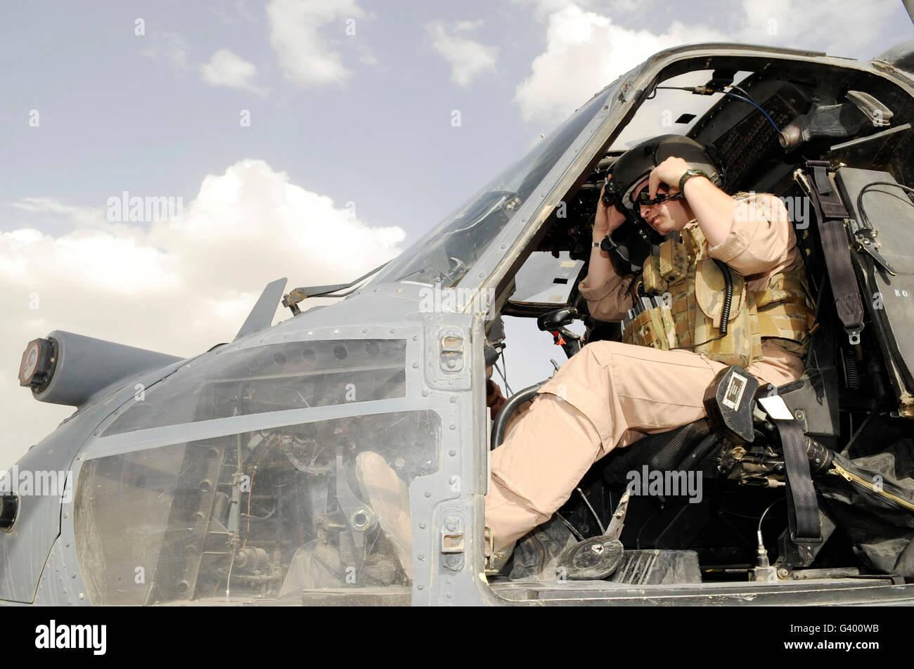 A pilot conducts preflight checks inside of a HH-60G Pave Hawk. - Stock Image