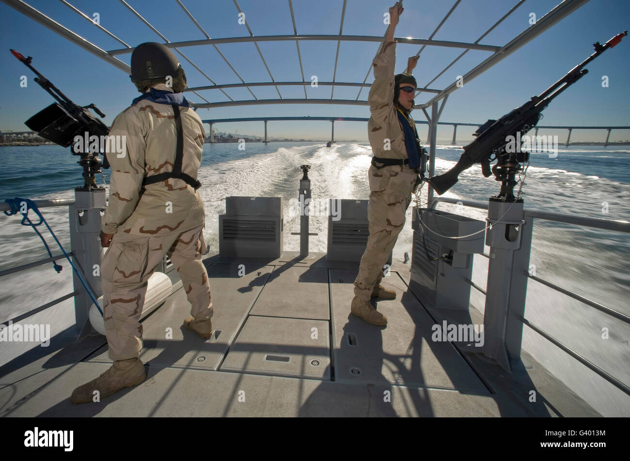 Soldiers serve as aft lookouts on a patrol boat, San Diego Bay. Stock Photo