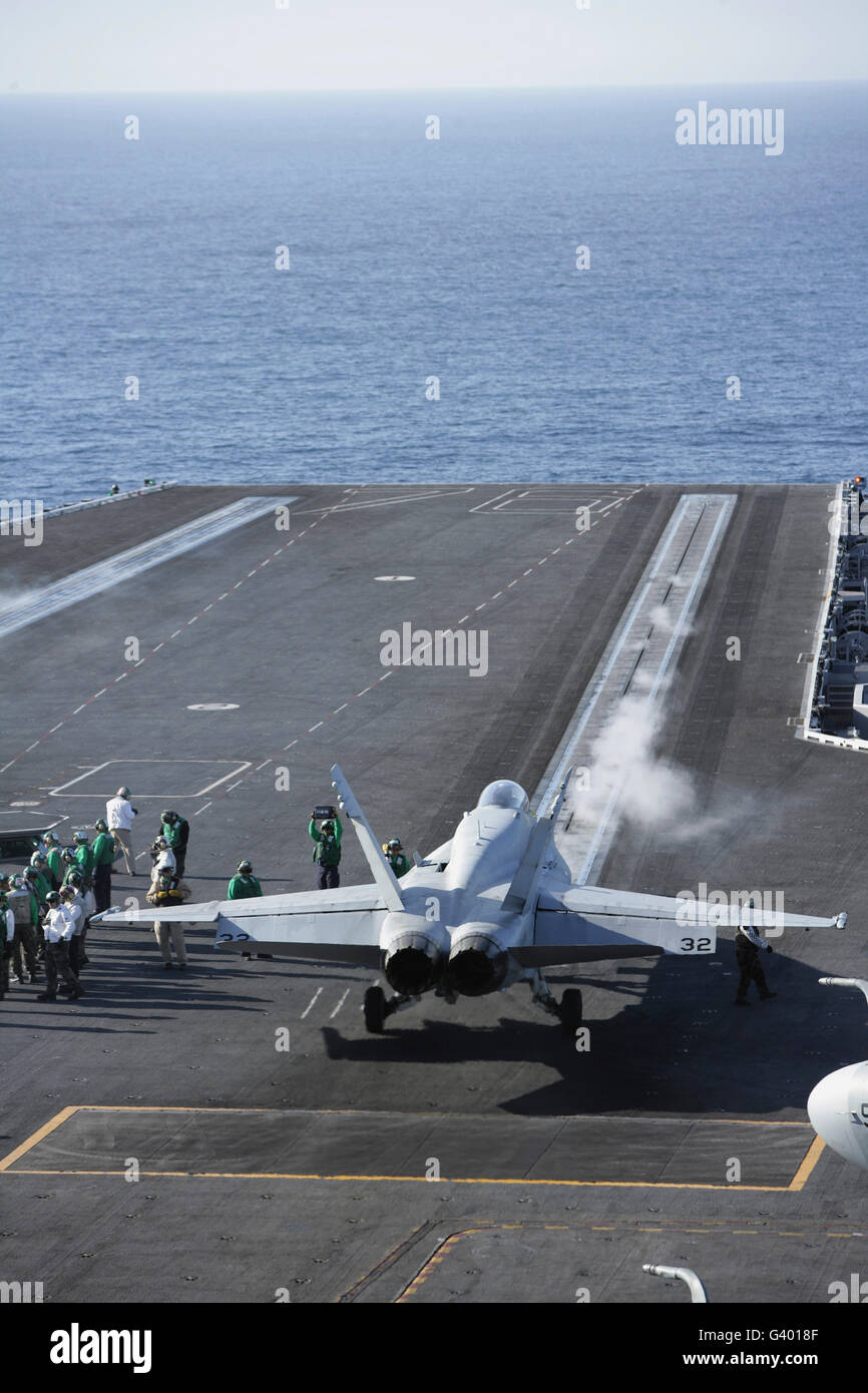 An FA-18D Hornet launches from the aircraft carrier USS Ronald Reagan. - Stock Image