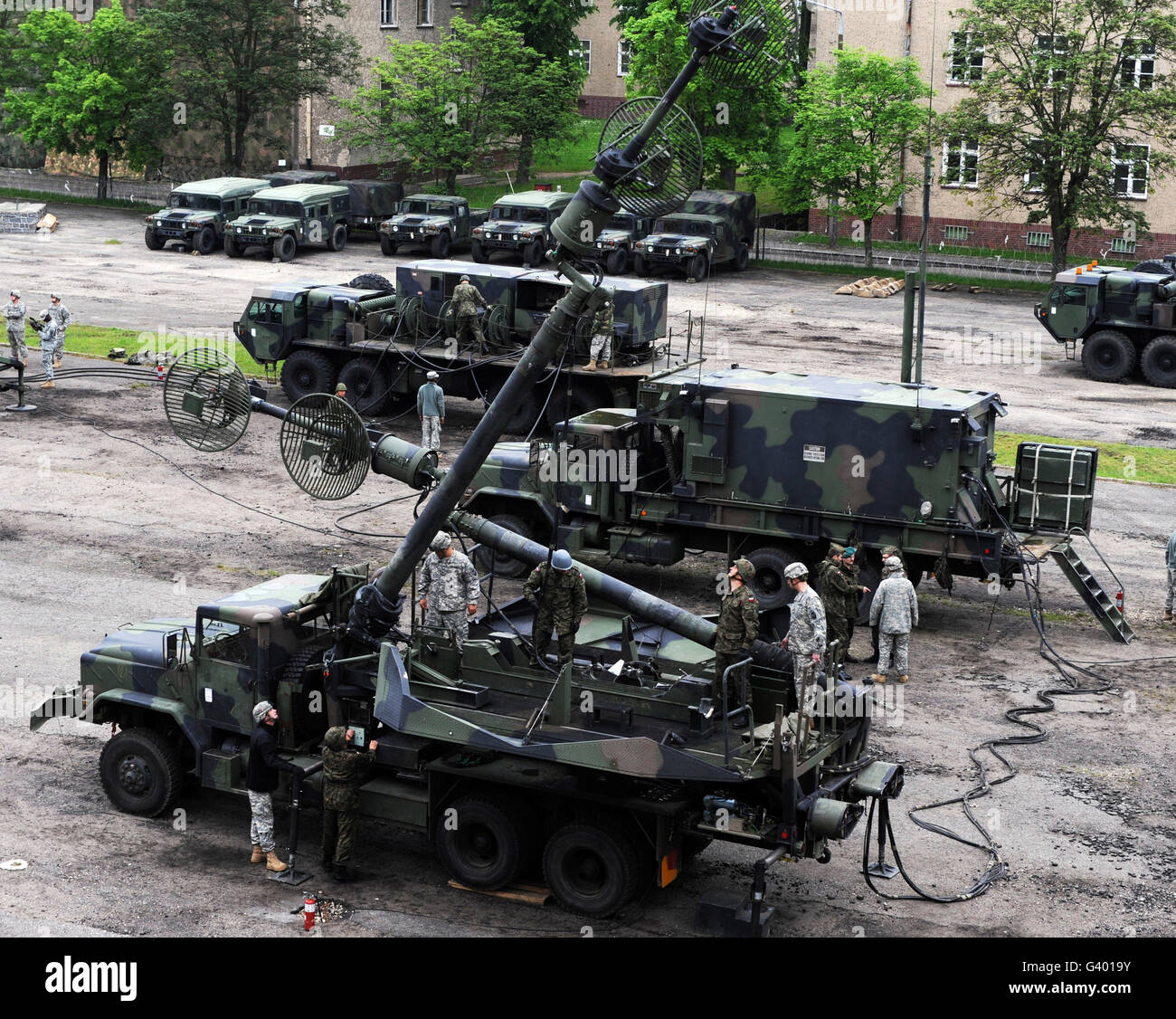 U.S. Soldiers train Polish service members on preventive maintenance for the Patriot missile system. - Stock Image