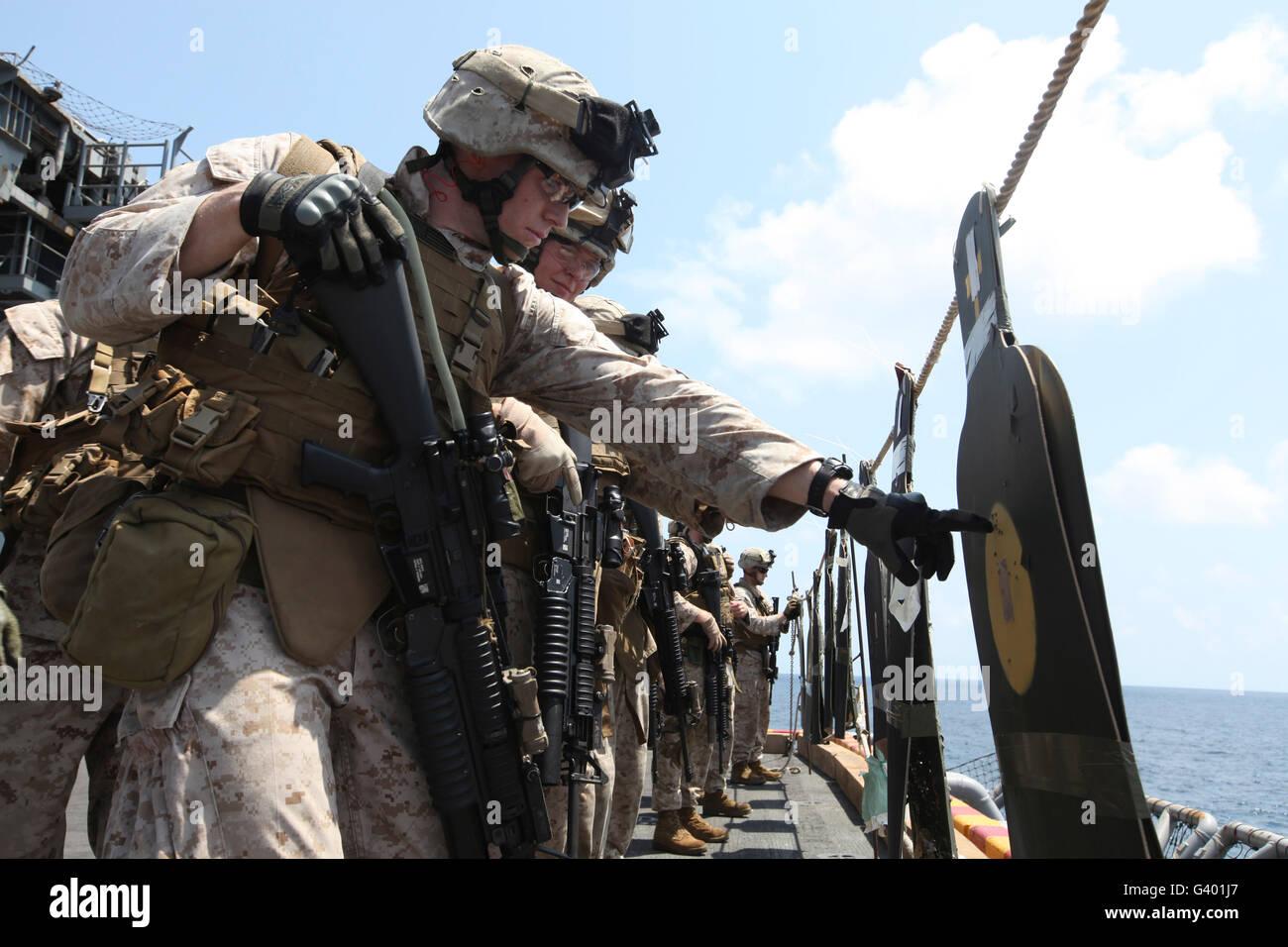 U.S. Marine looks over his target during a combat marksmanship program. -  Stock Image
