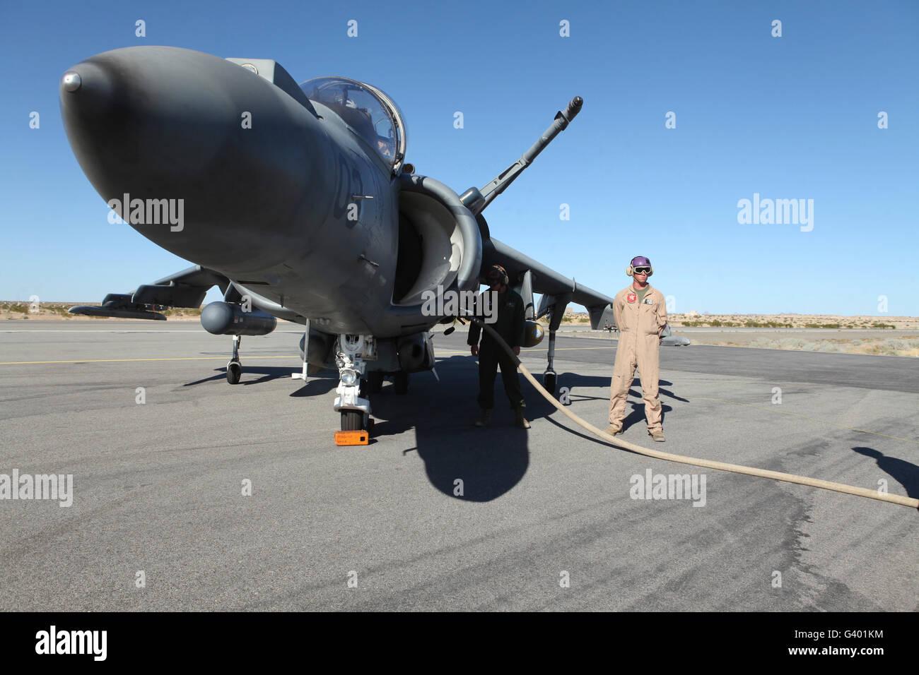 U.S. Marine Corps air crewmen refuel an AV-8B Harrier II aircraft. Stock Photo