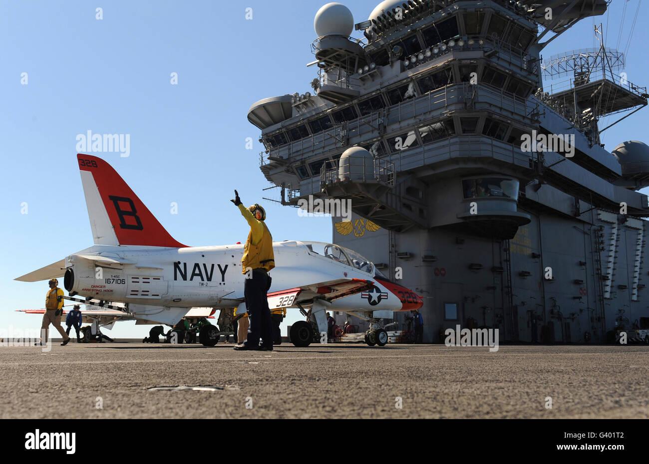 A T-45C Goshawk training aircraft on the flight deck of USS George H.W. Bush. - Stock Image