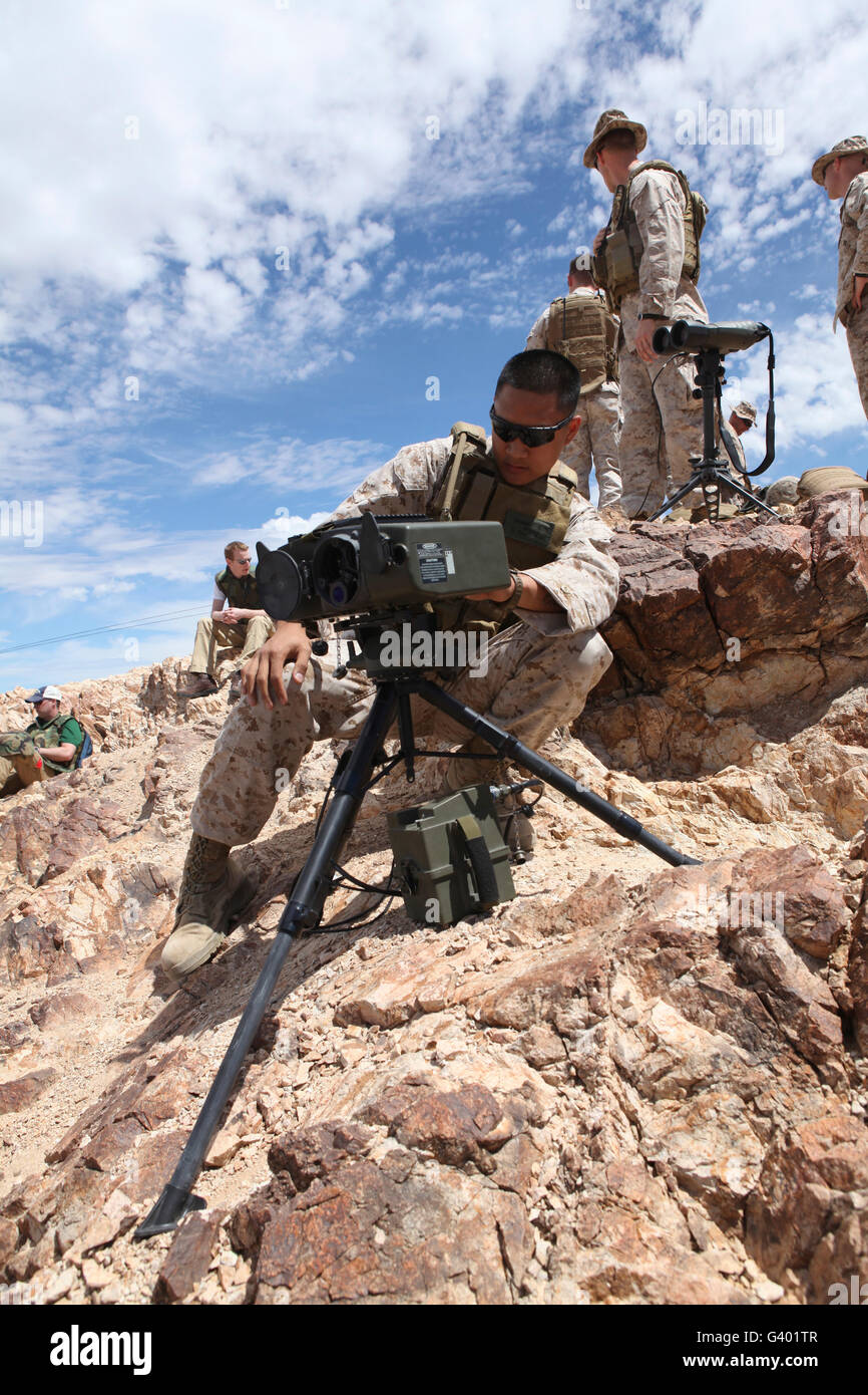 A Marine sets up a laser designator on the Chocolate Mountains. - Stock Image