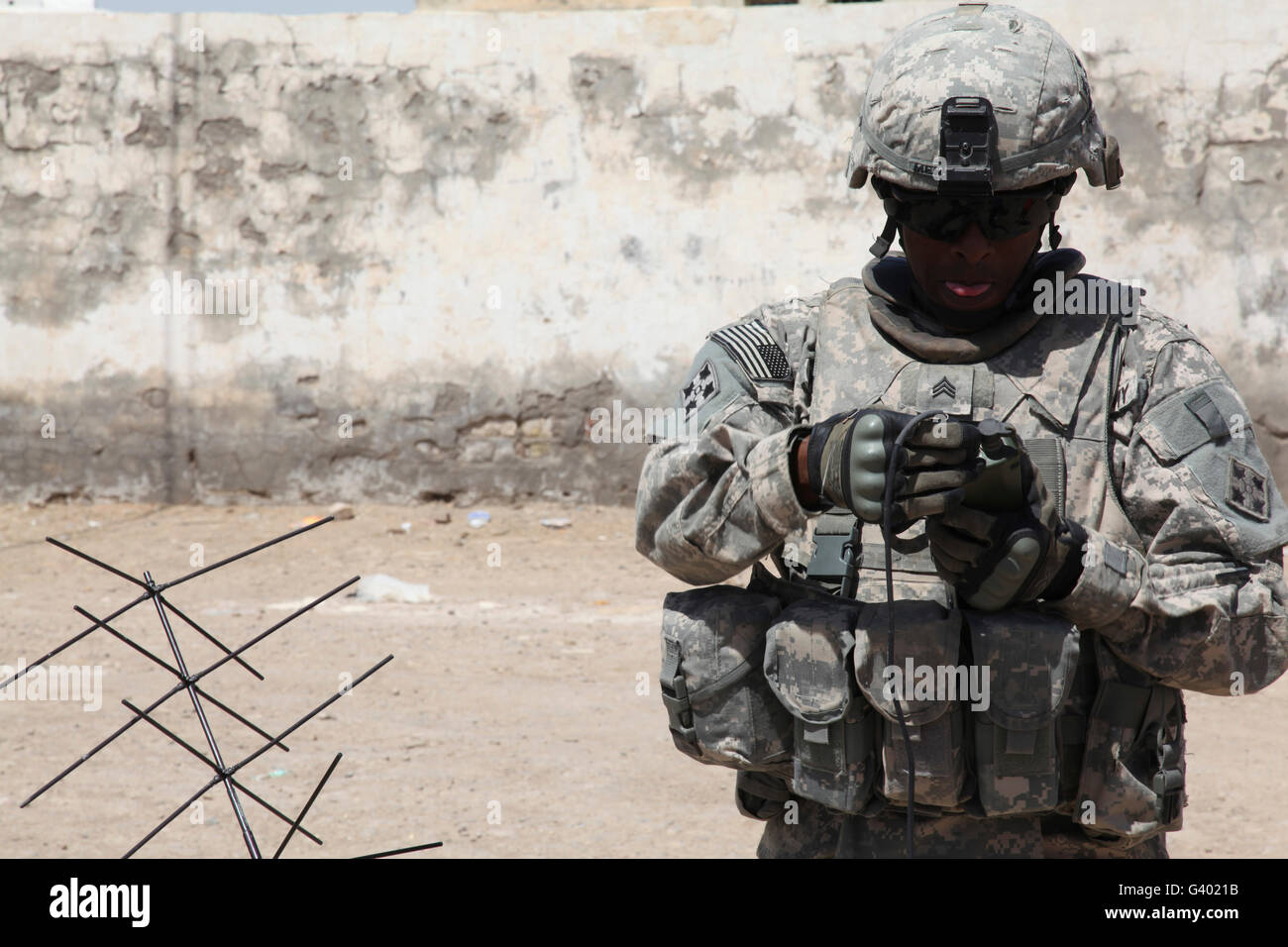 A U.S. Soldier tests a tactical satellite radio. - Stock Image