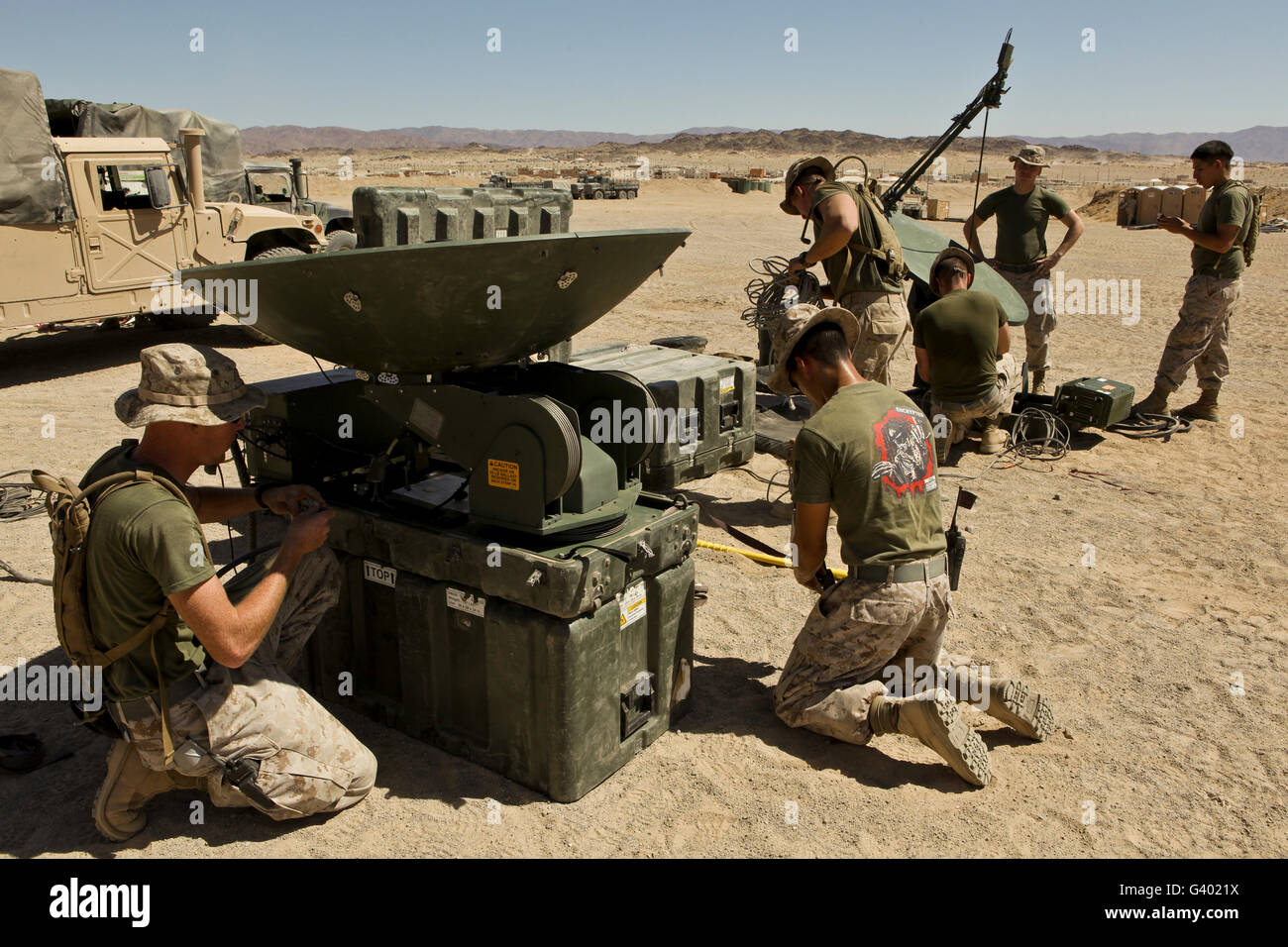U.S. Marines assemble a satellite dish. - Stock Image