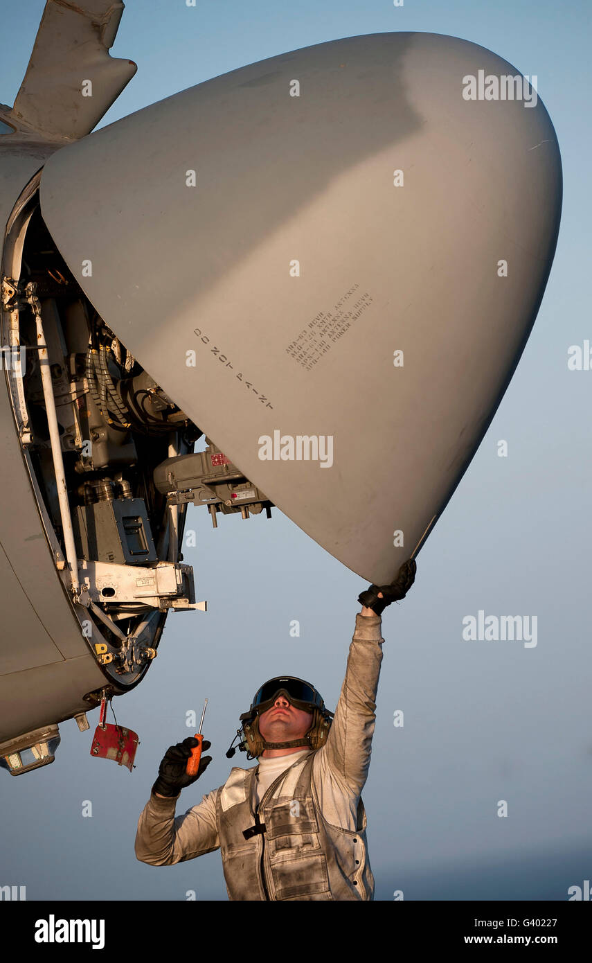 Petty Officer inspects the radar of an EA-6B Prowler. - Stock Image