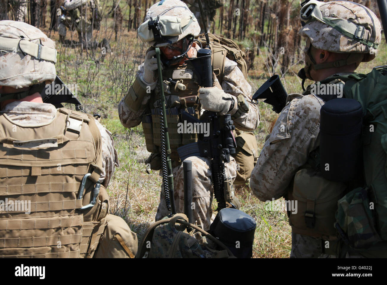 Marines communicate with other elements via radio at Camp Lejeune. - Stock Image