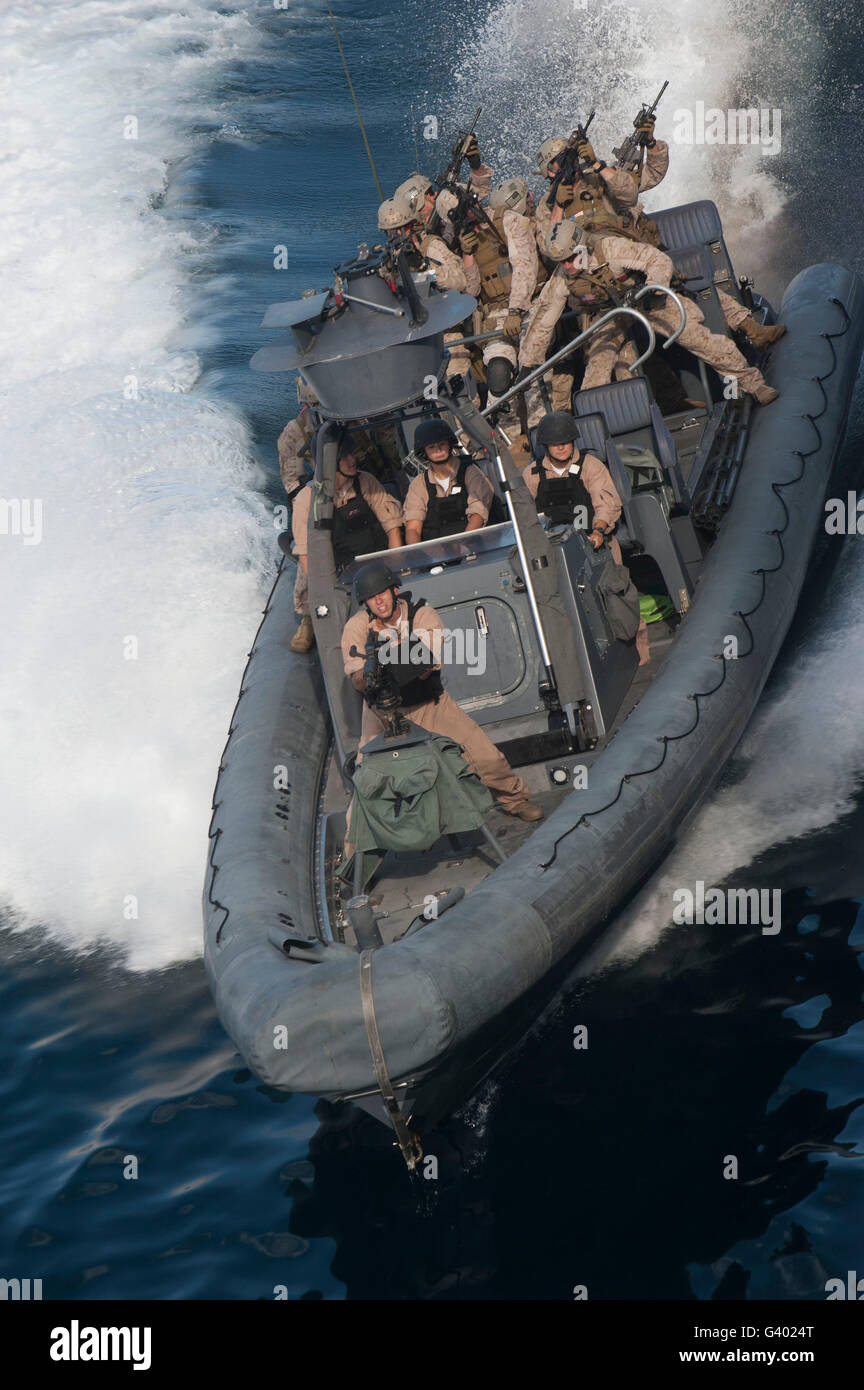 Sailors operate a rigid-hull inflatable boat. - Stock Image