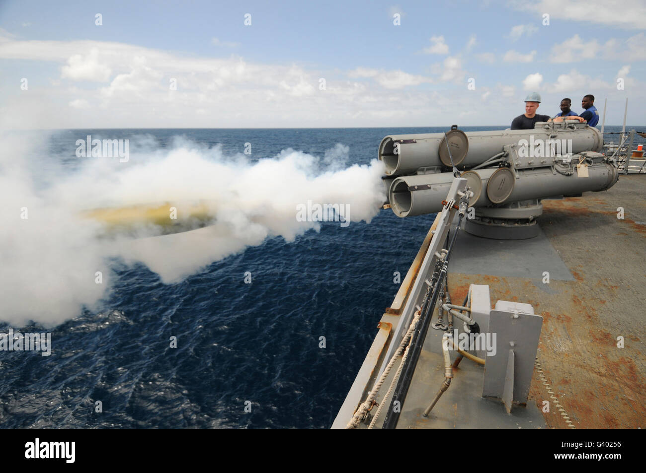 Sailors observe a MK-46 recoverable exercise torpedo launch aboard USS Mitscher. - Stock Image