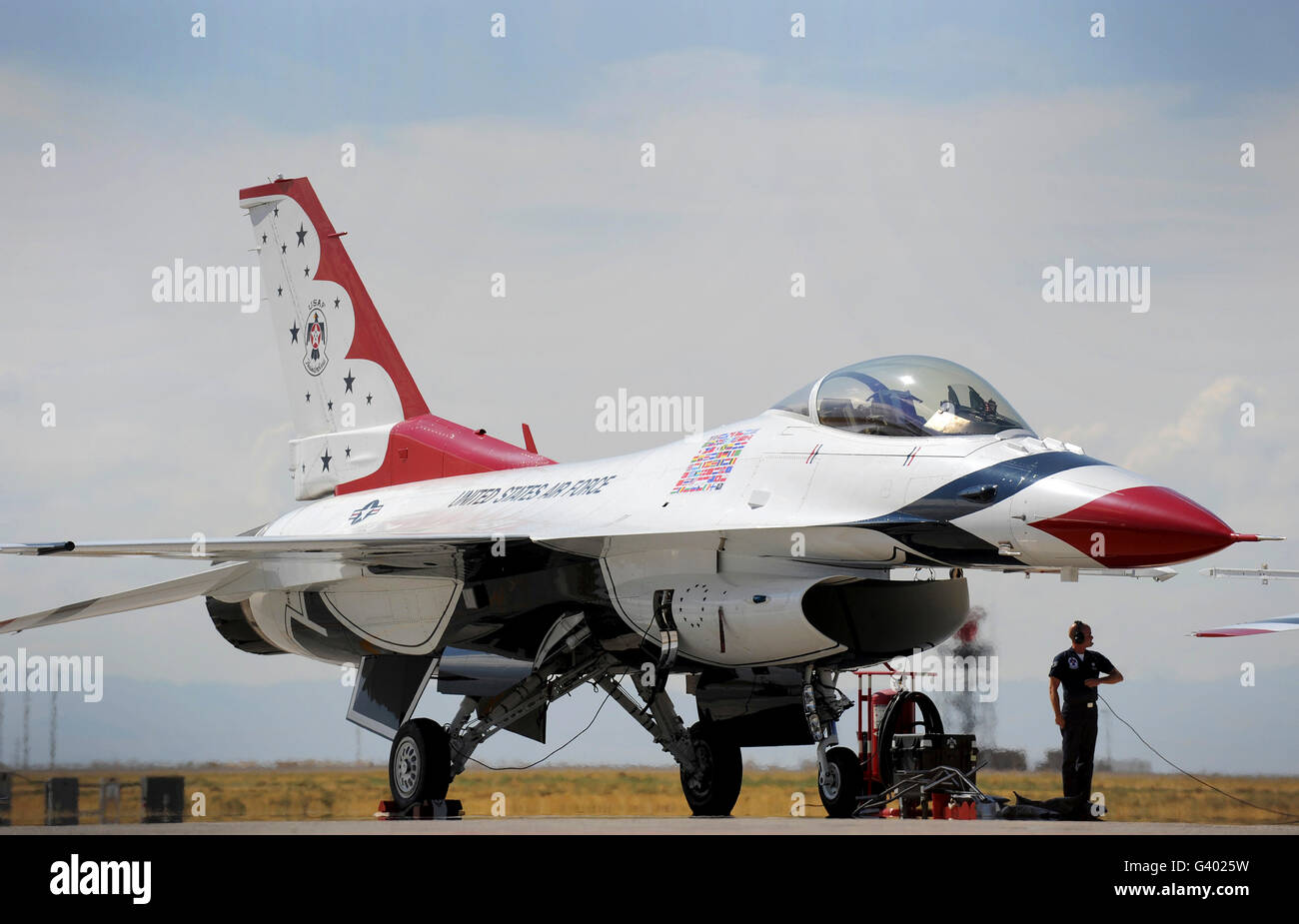 Preflight checks are performed on a U.S. Air Force Thunderbirds aircraft. - Stock Image