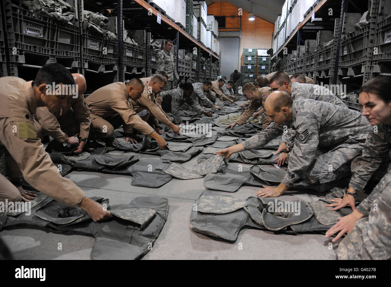 Airmen inspect their Improved Outer Tactical Vests. - Stock Image