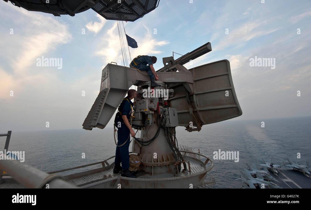 Technicians performs maintenance on the SPN-43 radar aboard USS John C. Stennis. - Stock Image