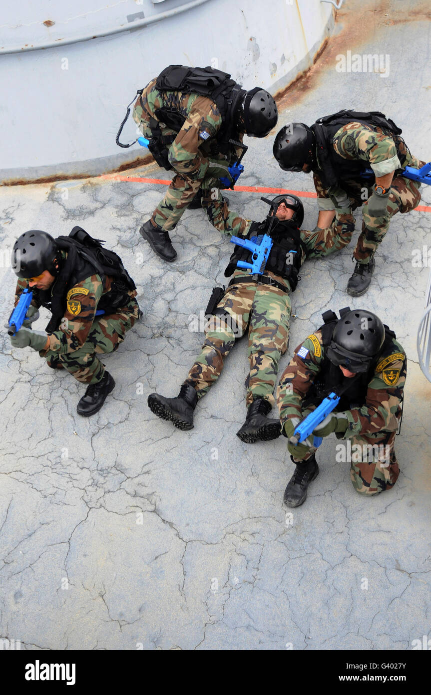 Members of the Greek Navy practice removing a casualty as part of training. - Stock Image