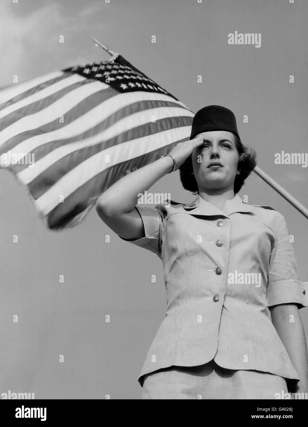 A Woman in the Air Force Officer gestures a salute. - Stock Image