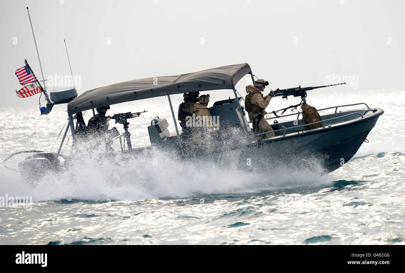 Sailors patrol Kuwait Naval Base's harbor. - Stock Image