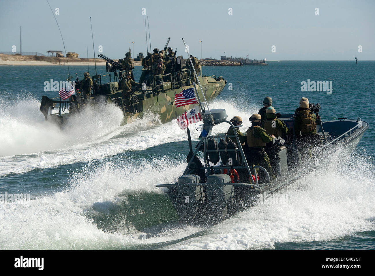 Riverine Command Boats and security boats practice maneuvers. - Stock Image