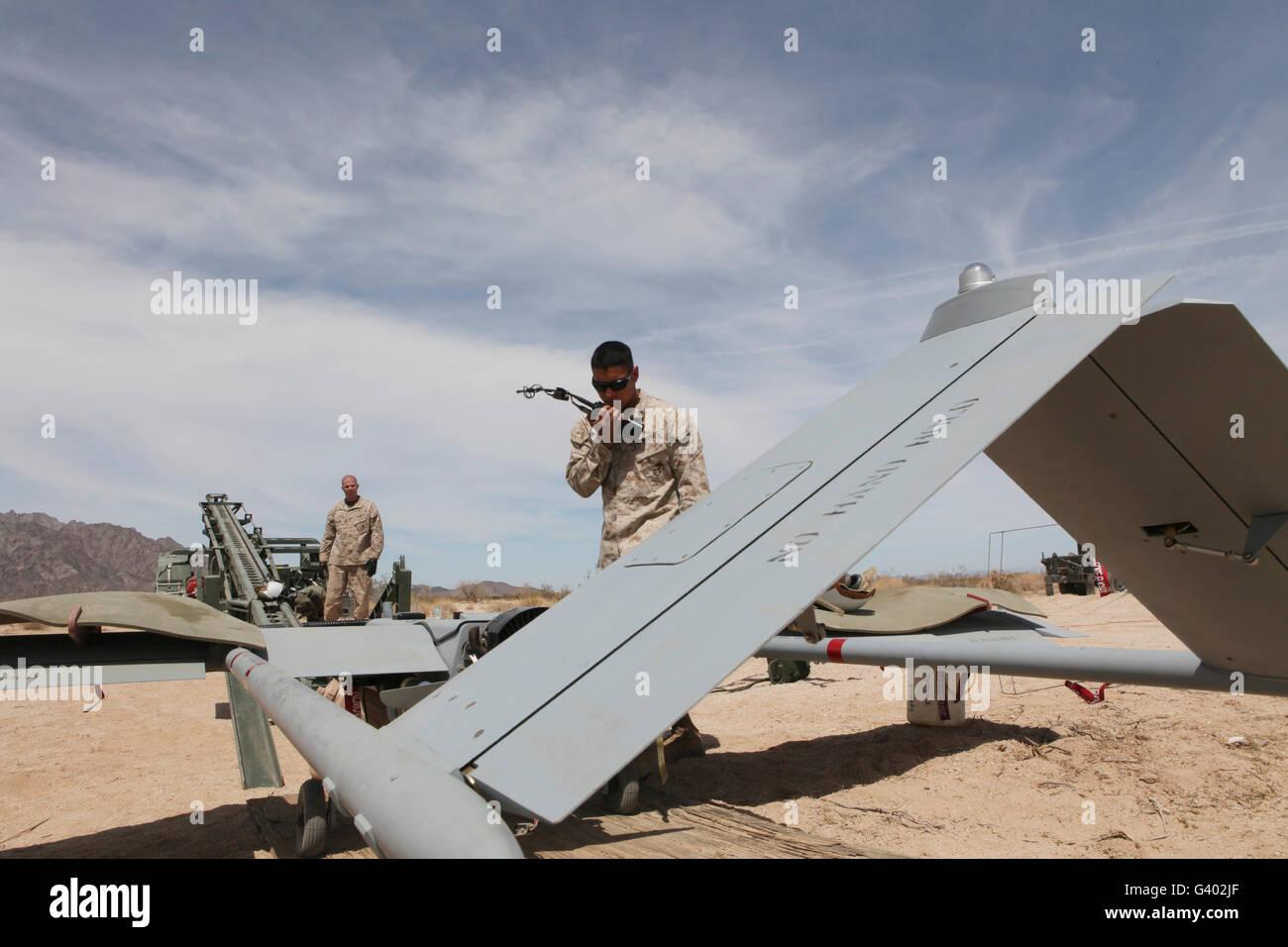 U.S. Marine performs a final preflight check on an RQ-7 Shadow. - Stock Image