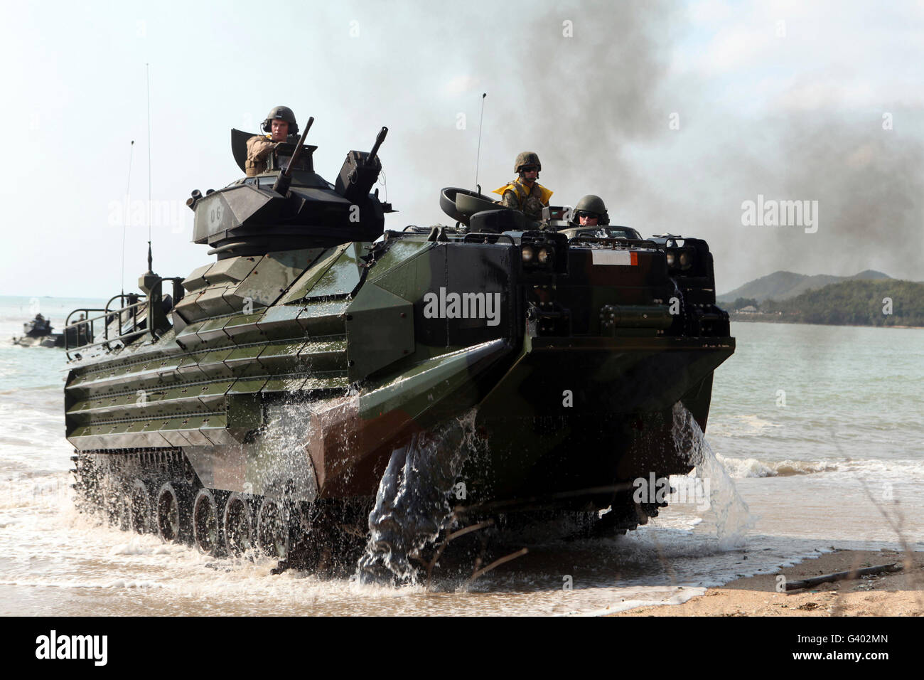 An amphibious assault vehicle hits the beach during a mechanized raid. - Stock Image
