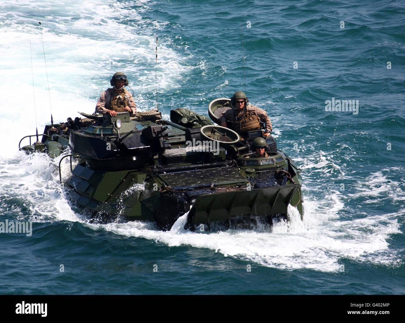 Marines operate an amphibious assault vehicle. Stock Photo
