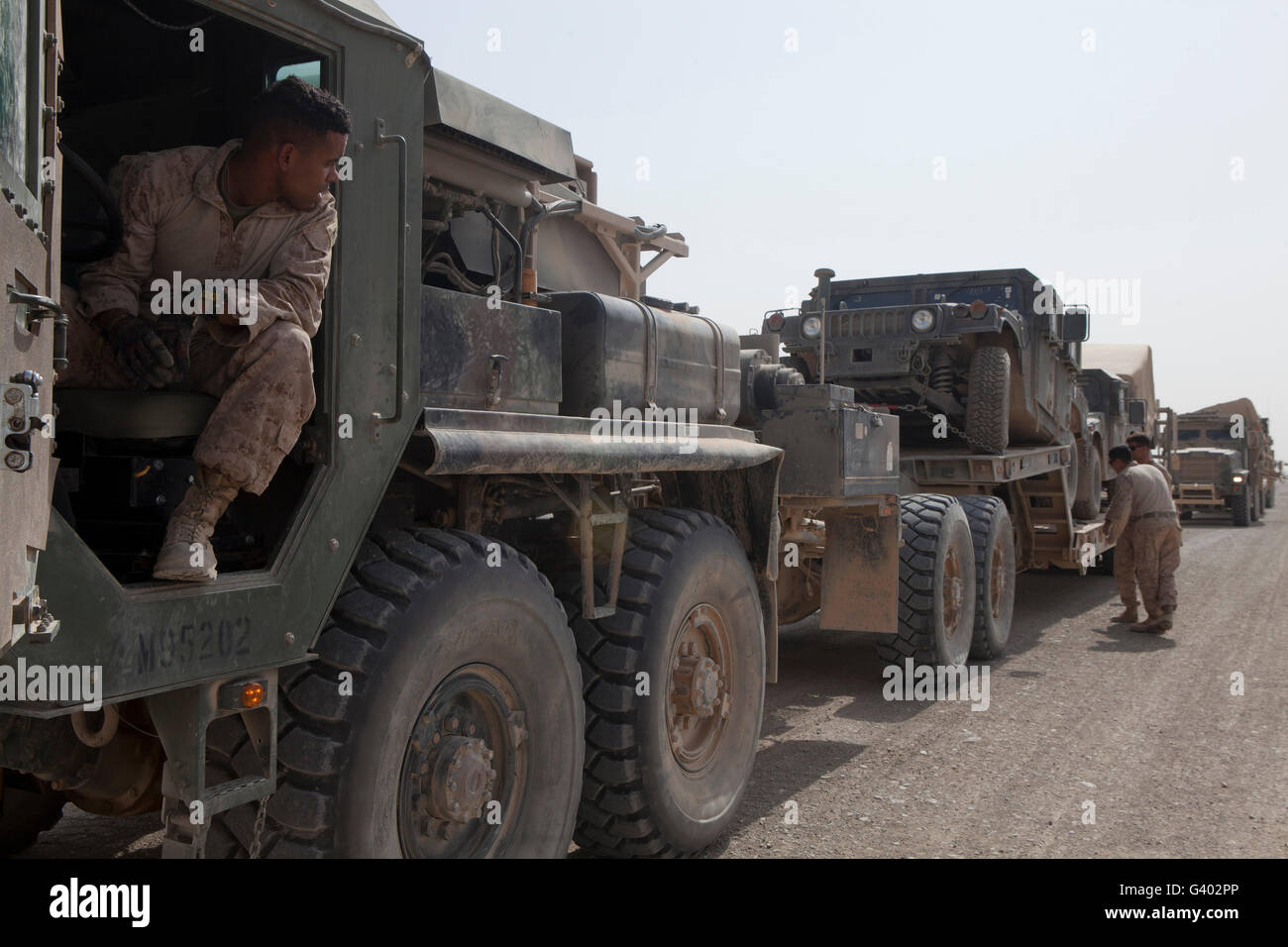 A MK48 Logistics Vehicle System is inspected prior to unloading. - Stock Image