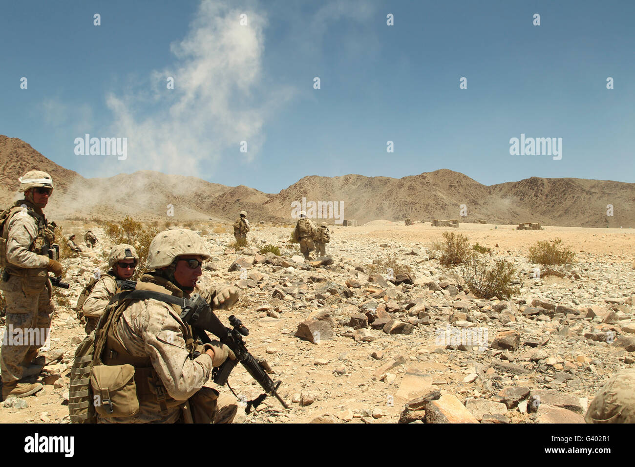 Rifleman gives his team the command to cease fire. - Stock Image