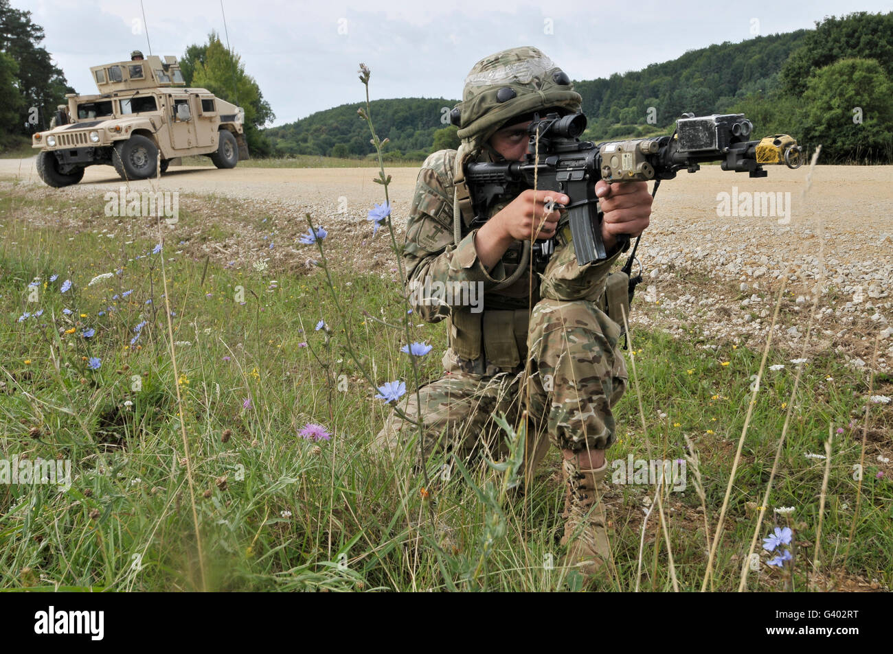Georgian Army Sergeant aims an M4 carbine. - Stock Image